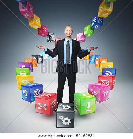 business man  on abstract icons cubes