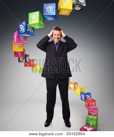 despareat businessman and icons cubes