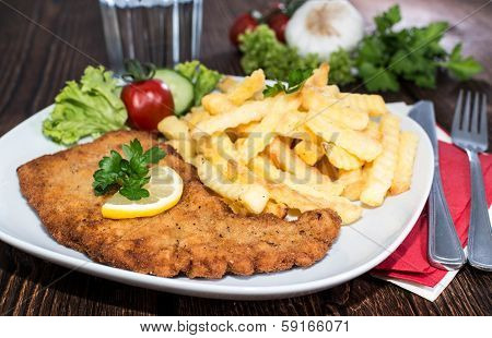 Portion Of Schnitzel With Chips