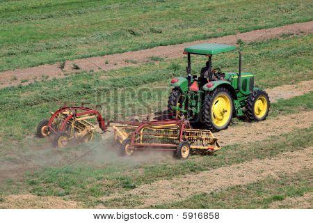 Tractor Raking Hay