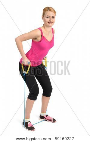 Female back and arms exercise using rubber resistance band
