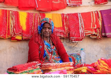 JODHPUR, INDIA - FEBRUARY 11: An unidentified woman sells cloth at Sadar Market on February 11, 2011