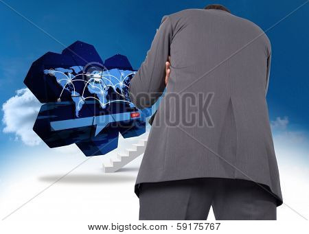 Thinking businessman against steps leading to closed door in the sky