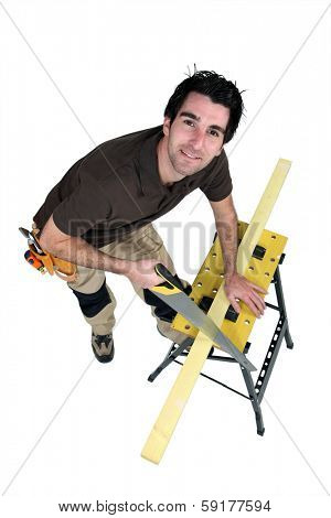 Carpenter sawing.