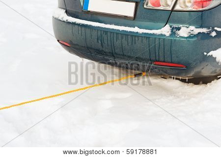 transportation, winter and vehicle concept - closeup of towing car with towing rope