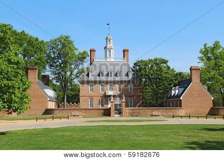 The Governors Palace Building In Colonial Williamsburg, Virginia, Against A Bright Blue Sky