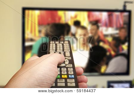 Television remote control changes channels thumb