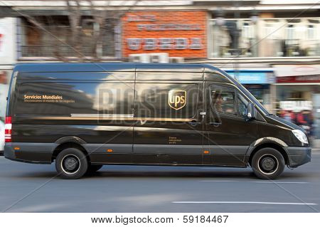 VALENCIA, SPAIN - JANUARY 28, 2014: UPS delivery van on the street in Valencia. UPS is one of largest package delivery companies worldwide with 397,100 employees and USD 54.1 billion revenue (2012).