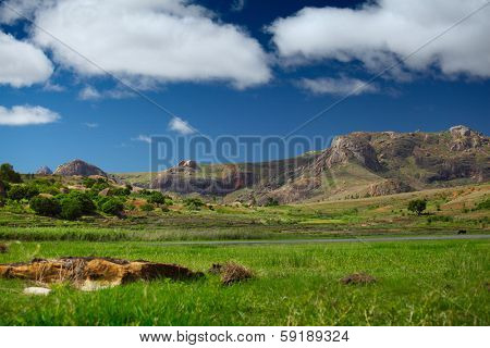 Mountains of Anja National Park at sunny day and fluffy clouds in the sky. Madagascar