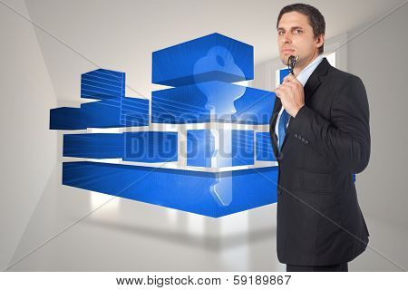 Thinking businessman holding glasses against bright hall with windows