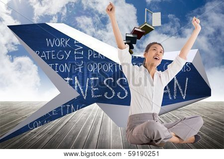 Businesswoman sitting cross legged cheering against book steps leading to door on sky