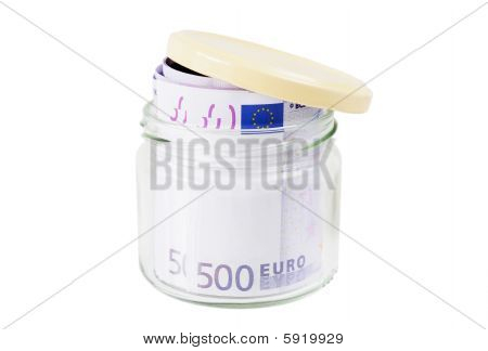 Rolled 500 Euro Banknotes In A Jar