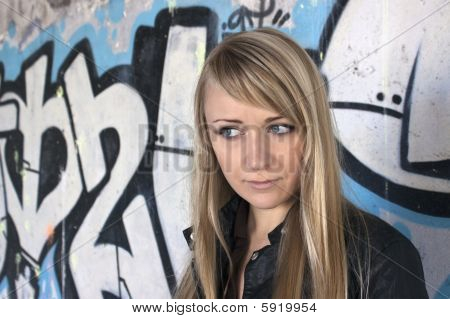 Female Model Standing At Graffiti Wall