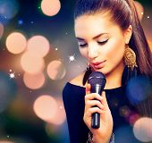 stock photo of blinking  - Beautiful Singing Girl - JPG