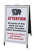 stock photo of shoplifting  - Sign warning shop is under constant surviellance - JPG