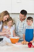 picture of flour sifter  - Parents assisting children in baking cookies at kitchen counter - JPG