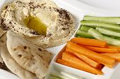 stock photo of crudites  - A dip tray with hummus - JPG