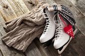 pic of skate board  - The white ice skates on old wooden boards - JPG