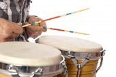 pic of bongo  - Male figure playing and drumming on bongo set on his lap with drum sticks