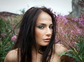 image of seminude  - Seminude beautiful girl among the flowers and old concrete wall background - JPG