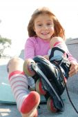 Child Putting On Her Rollerblade Skate