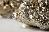 stock photo of iron pyrite  - Golden pyrite stone specimen with shiny reflections - JPG