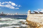 foto of el morro castle  - Tower and cannons of the castle of El Morro with the Havana skyline clearly visible in the background - JPG