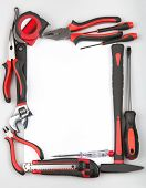 picture of pliers  - Tool set forming a frame on white background - JPG