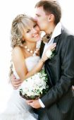 picture of wedding couple  - young adorable bride and groom over white portrait - JPG