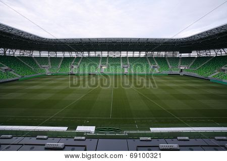 Soccer arena with green empty grandstands