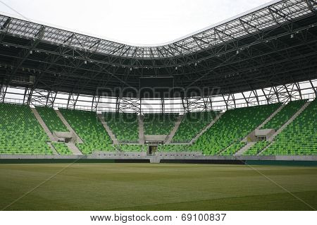 Stadium with grandstand. Empty green bleachers at Ferencvaros Budapest stadium.