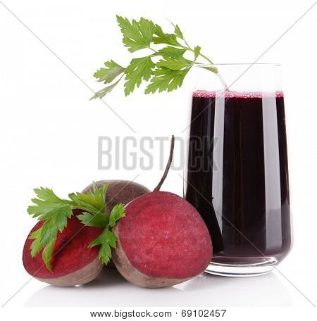 Glass of fresh beet juice and vegetables isolated on white