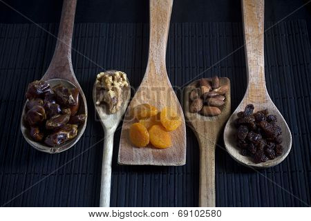 Dried Fruit and Nuts on Wooden Spoons from Above