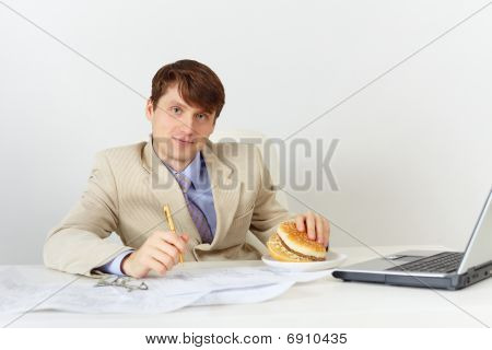 Businessman Is Going To Eat Delicious Sandwich Without Interrupting Work