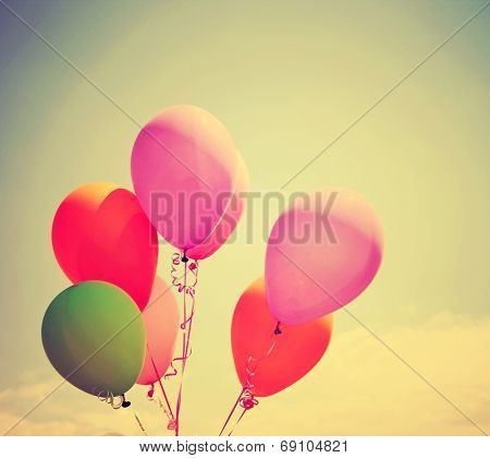 multi colored balloons toned with a retro vintage instagram like filter