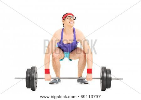 Nerdy guy struggling to lift a barbell isolated on white background