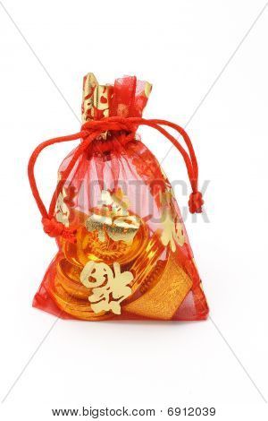 Chinese New Year Gold Ingots And Coins In Red Decorative Sachet