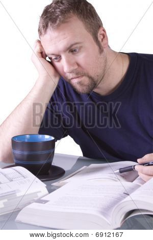 College Student With Books On The Table Studying