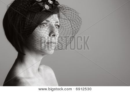 Attractive Woman In Black Veil