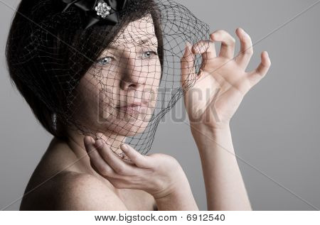 Attractive Woman Holding Black Veil