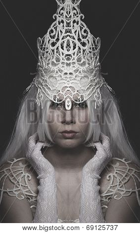 Queen of Winter woman wearing crown and white lace