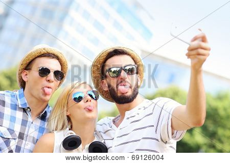 A picture of a group of friends taking a picture in the park