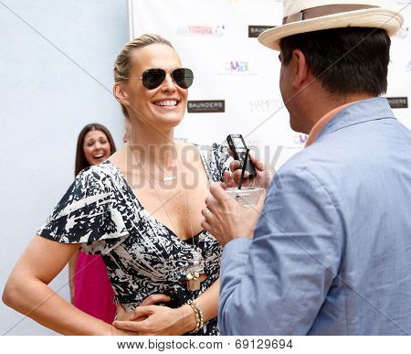 BRIDGEHAMPTON, NY-JUL 19: Actress Molly Sims attends the 6th Annual Family Fair at the Children's Museum of the East End (CMEE) on July 19, 2014 in Bridgehampton, New York.