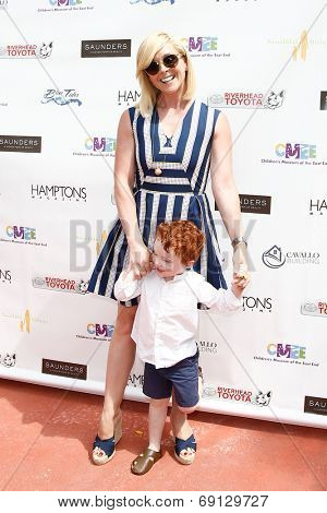 BRIDGEHAMPTON, NY-JUL 19: Actress Jane Krakowski and son Bennett attend the 6th Annual Family Fair at the Children's Museum of the East End (CMEE) on July 19, 2014 in Bridgehampton, New York.