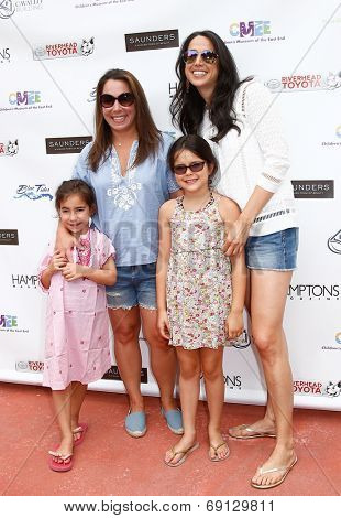 BRIDGEHAMPTON, NY-JUL 19: Hamptons magazine editor Samantha Yanks (L) & daughter Sadie attend the Family Fair at Children's Museum of the East End (CMEE) on July 19, 2014 in Bridgehampton, New York.