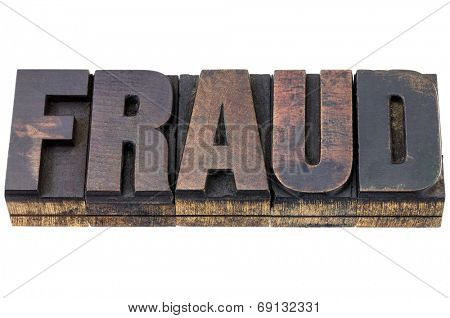 fraud word - isolated text in vintage letterpress wood type with ink patina