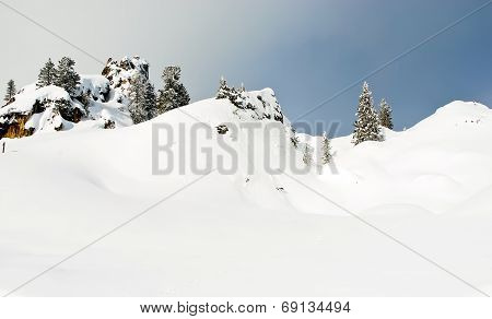 Snowbound Mountain Slope In Dolomites, Italy