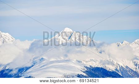 Snow-covered Mountain Peak In Dolomites, Italy