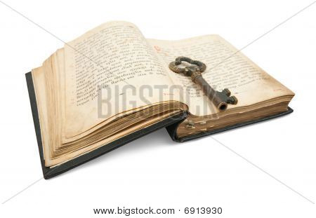 Key Placed On Vintage Book