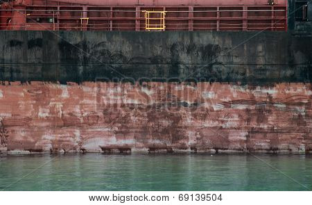 Black And Red Cargo Ship Hull Side Texture And Water